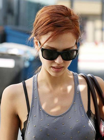 Kat has chosen a bold, bright red hue where as Jessica Alba's red hair is a